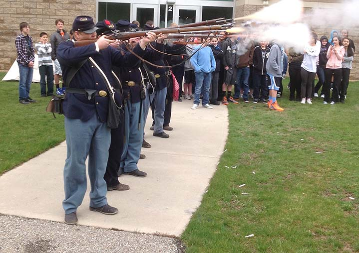 Civil War re-enactors line up for battle at Byron Center West Middle School