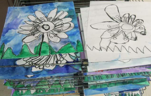 Artwork is stacked to dry in the Kent City Elementary School art room