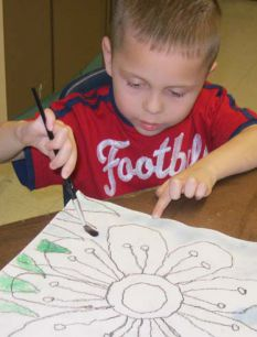 Kent City Elementary School kindergartner Blake Klimek focus on his painting