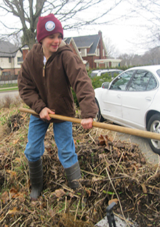 "East Grand Rapids Middle School sixth grade Teddy Drake lends a hand during ""Spring Greening."""