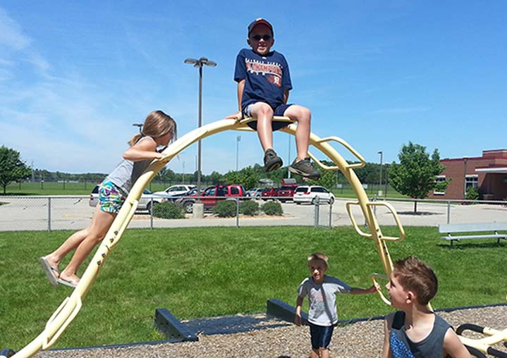 Students hit the playground after lunch during Summer Fun Camp
