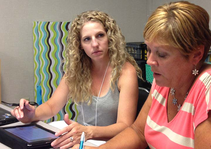 Fifth grade teachers Olivia Alkema and Diane Zadel work in a collaborative project during Rebel U development program at Godfrey Lee's Sixth grade building last week