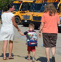 Teachers lead the last student to his bus on the first day kindergarteners rode the bus home at Caledonia Community Schools. He was the only student who had trouble finding his bus, due to a paperwork glitch