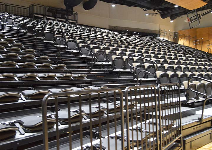 Retractable auditorium seating quickly transforms the facility from gymnasium to auditorium and back again