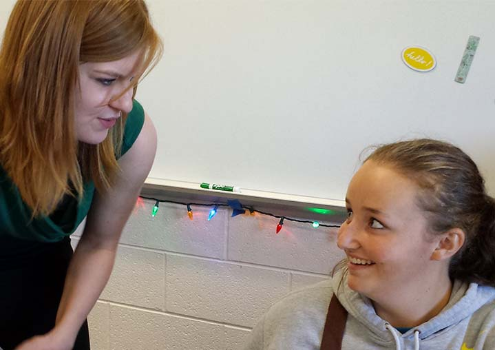 Mary Beth Hills talks to student Kylie Piatt about French