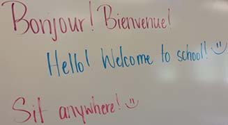 Messages in French and English greet students in Mary Beth Hills' French 1 class