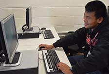 Chinese student Bill Liu gets to work in class at East Kentwood High School