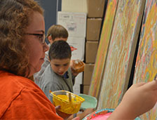 Sixth grader Mindy Markus adds to the mural