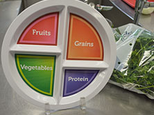 Food service staff members make sure a variety of food groups are represented in student meals