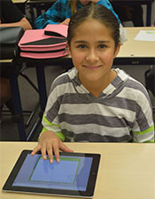 Sixth grade student Aleena Carter uses the touch screen