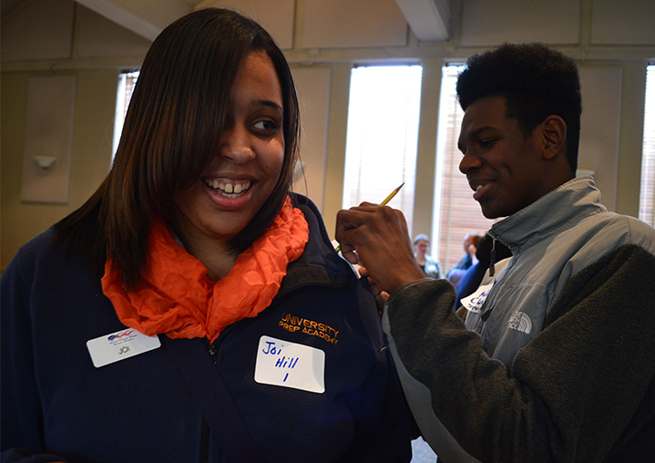 Joi Hill, a junior at Grand Rapids University Prep Academy waits for Malik Clincy, a Northview junior to write down an answer