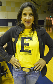 "Christy Buck, executive director the Mental Heath Foundation of West Michigan, wears her East Grand Rapids shirt with the messages ""Be Nice"" and ""Hearts of Gold"""