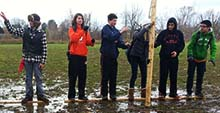 Students build a bridge across a flooded area