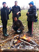 Students take a break from their quest to toast marshmallows and warm up