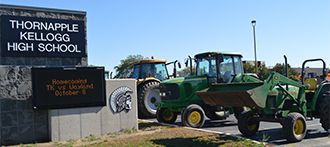 Tractors line up in the parking lot at Thornapple High School