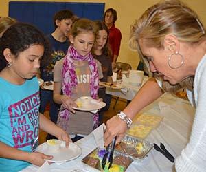 Principal Paula Dykstra serves students ethnic foods at International Food Day