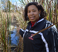 Teacher Dion Price helped retrieve water from the wetland