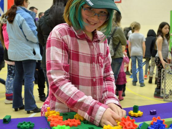 Third-grader Emily Carothers makes quick work of the Gears station