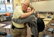 Hugs from students like Allison Klimek are nothing unusual for English teacher David Lyons