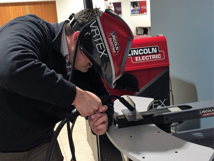 James Hissong, Kent ISD grants and development coordinator, tried his rather unsteady hand at welding, using a machine designed to teach welding skills using virtual reality technology