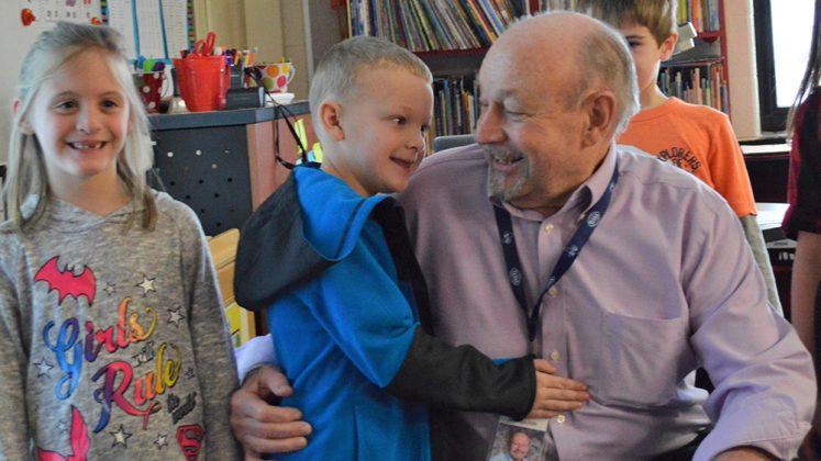 Elijah Barnum gets a hug from Grandpa Dale while Brookelynn Kerker waits her turn