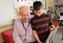 First-grader Jordan Eshraghi enjoys it when Grandpa Dale reads with him