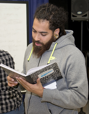 Marcel Price reads student work at a spoken-word poetry workshop run by a group of teaching artists called The Diatribe