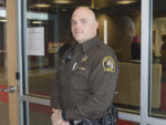 Northview school resource officer Deputy Andy Kozal stands in the security vestibule of Northview High School, one of many Kent County schools that have poured millions into security upgrades (SNN file photo)