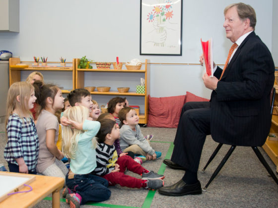 Children get a kick out of their superintendent reading to them; he clearly enjoys it as well