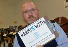Jeffrey Larsen, Lowell High School AP literature teacher, would rather be armed with school supplies