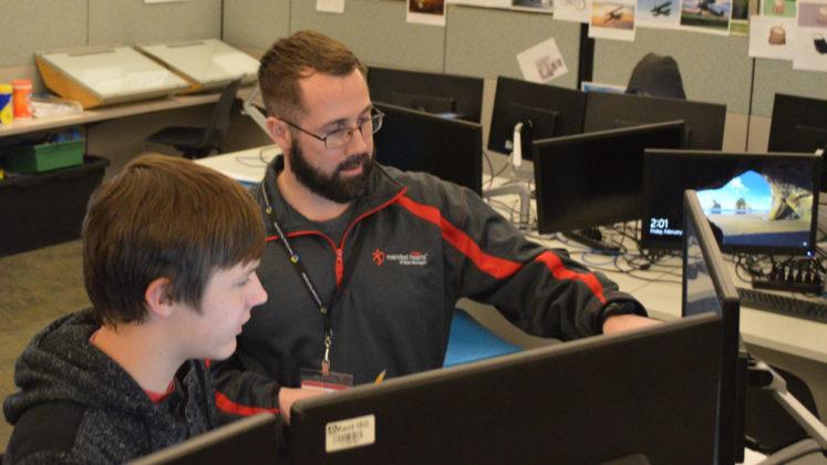 Marc Petz, 3D Instructor at Kent Career Tech Center, critiqued South Christian High School senior Mcguire VanderWal's anime character design