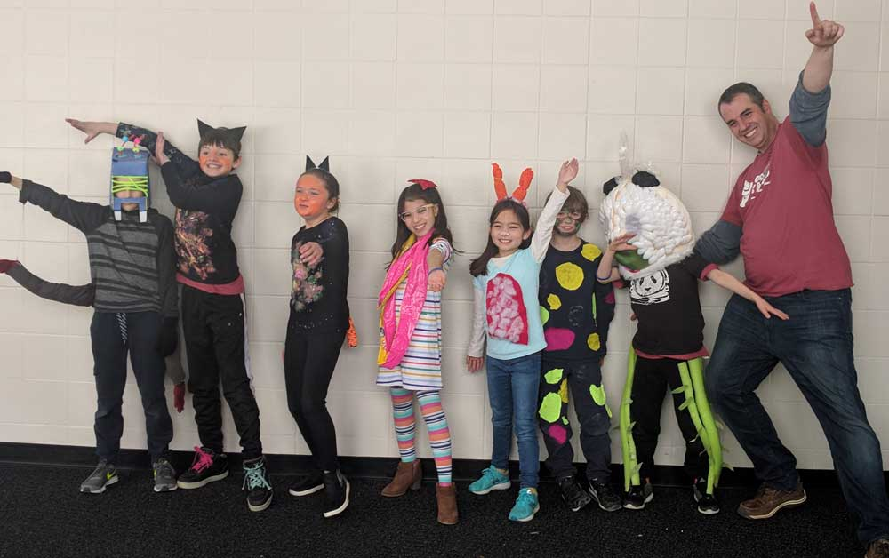 Wealthy Elementary's team from East Grand Rapids placed third in the Division 1, Problem 5 section at the Region 1 Odyssey of the Mind competition held at Northview High School. Pictured from left to right are third- and fourth-graders Joe Schulte, Gabe White, Ellie Hilgendorf, Farzona Urmonjonova, Nava Tabata, Fisher Swift, Ollie Cornell and coach Charlie White