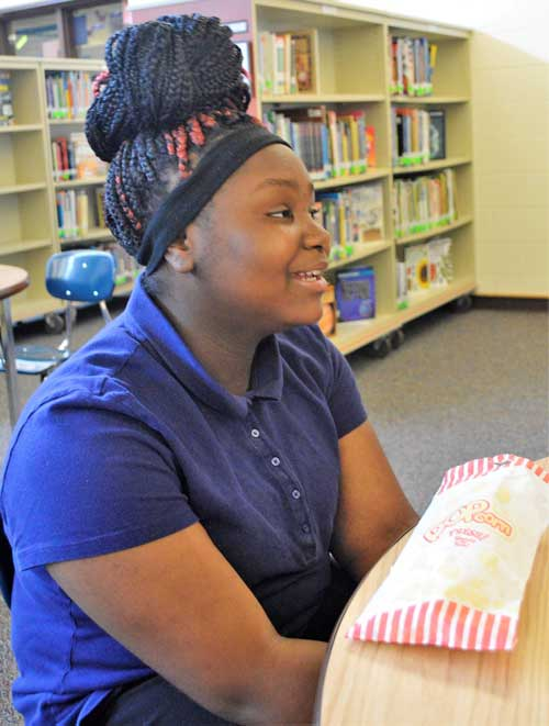 """It helps because I think about further goals, and what to do when I grow up,"" eighth-grader Danika Shaw says of her mentoring sessions"