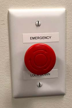 Each building is equipped with a panic button that shuts down access to the building