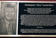 A plaque documenting high school principal Chris VanderSlice's work in the district has been mounted in the athletic wing