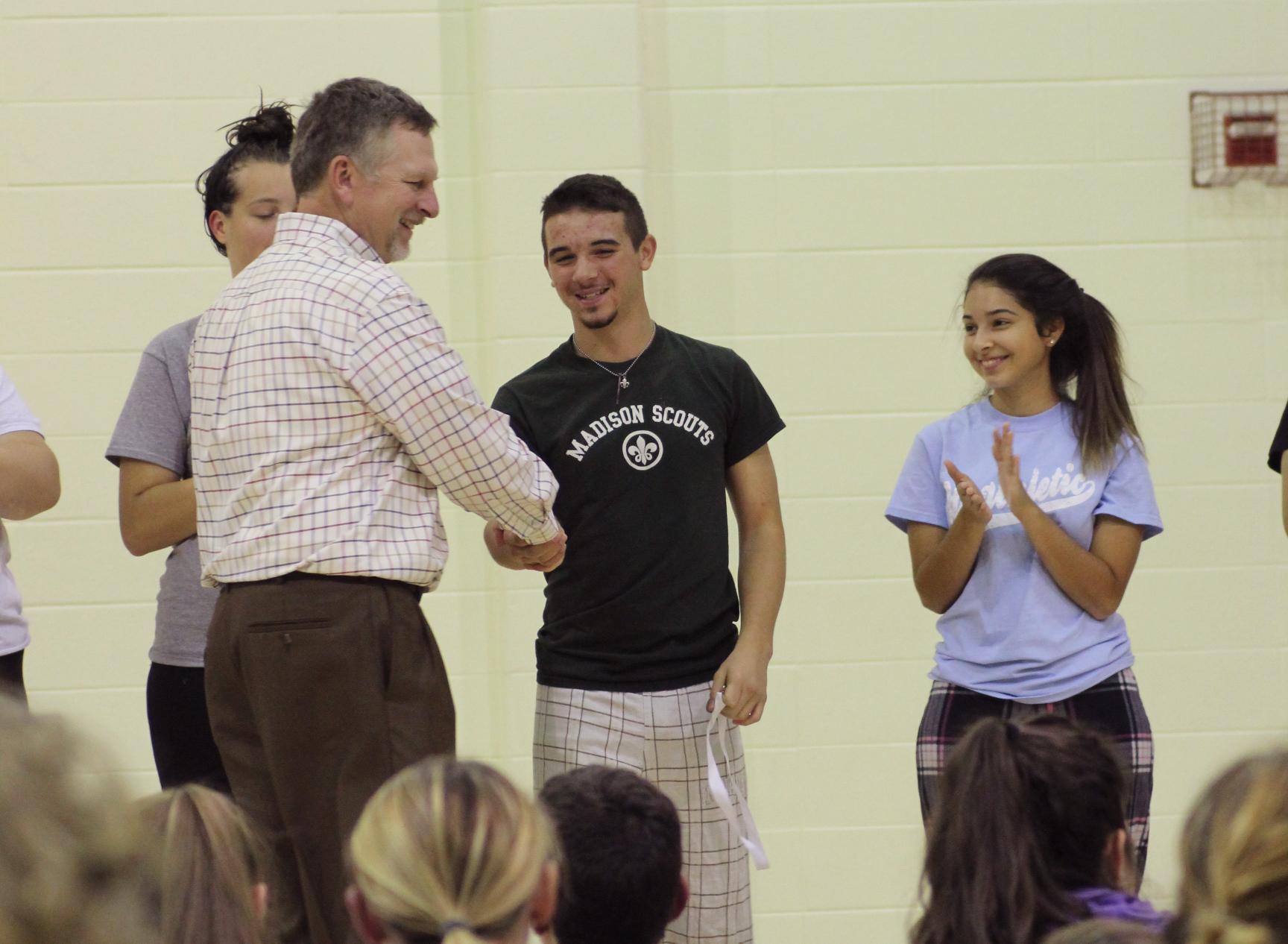 Keegan Anderson accepts a senior award.