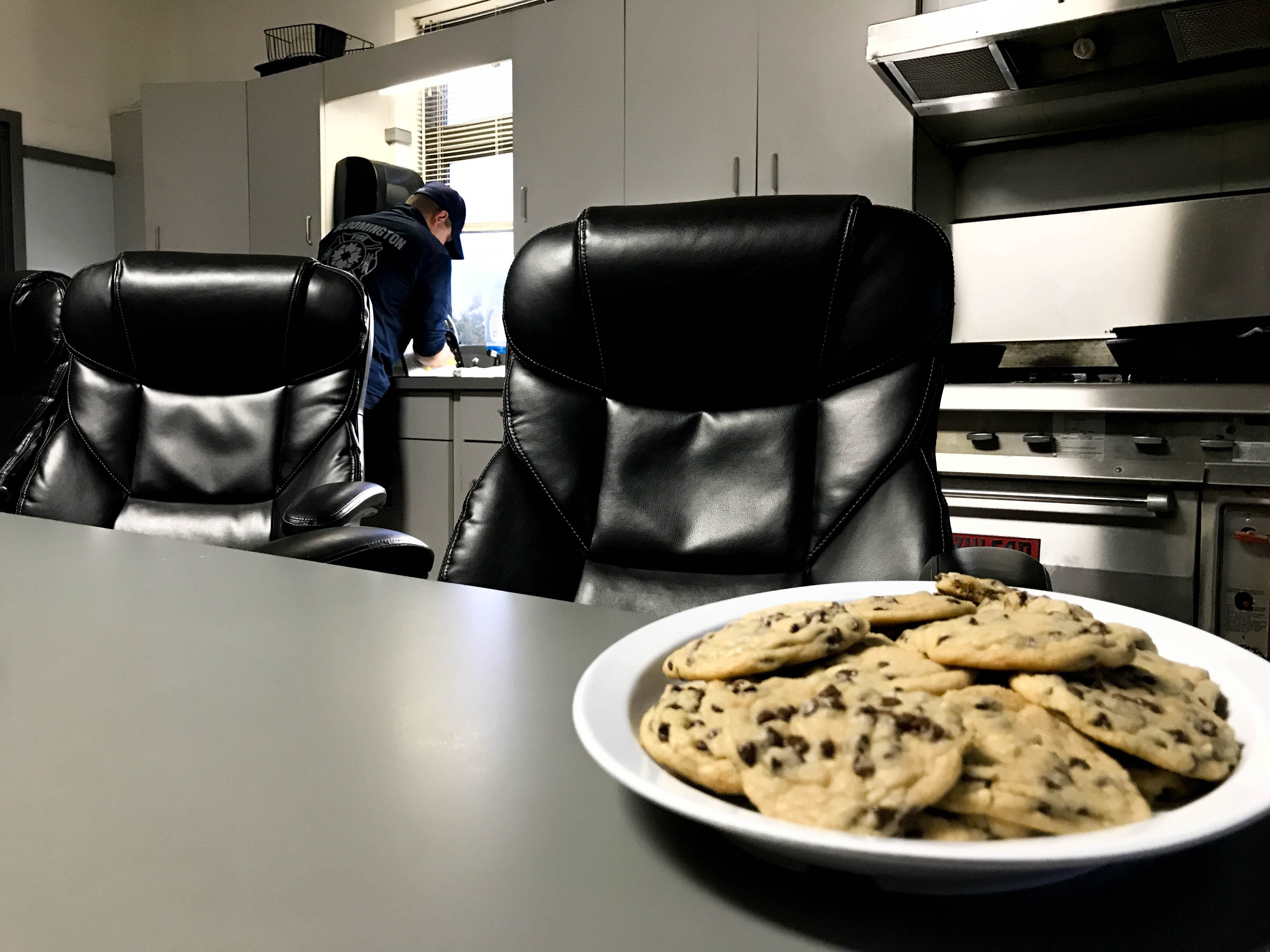 A plate of chocolate chip cookies sits on the kitchen table at the Bloomington Fire Department Headquarters.