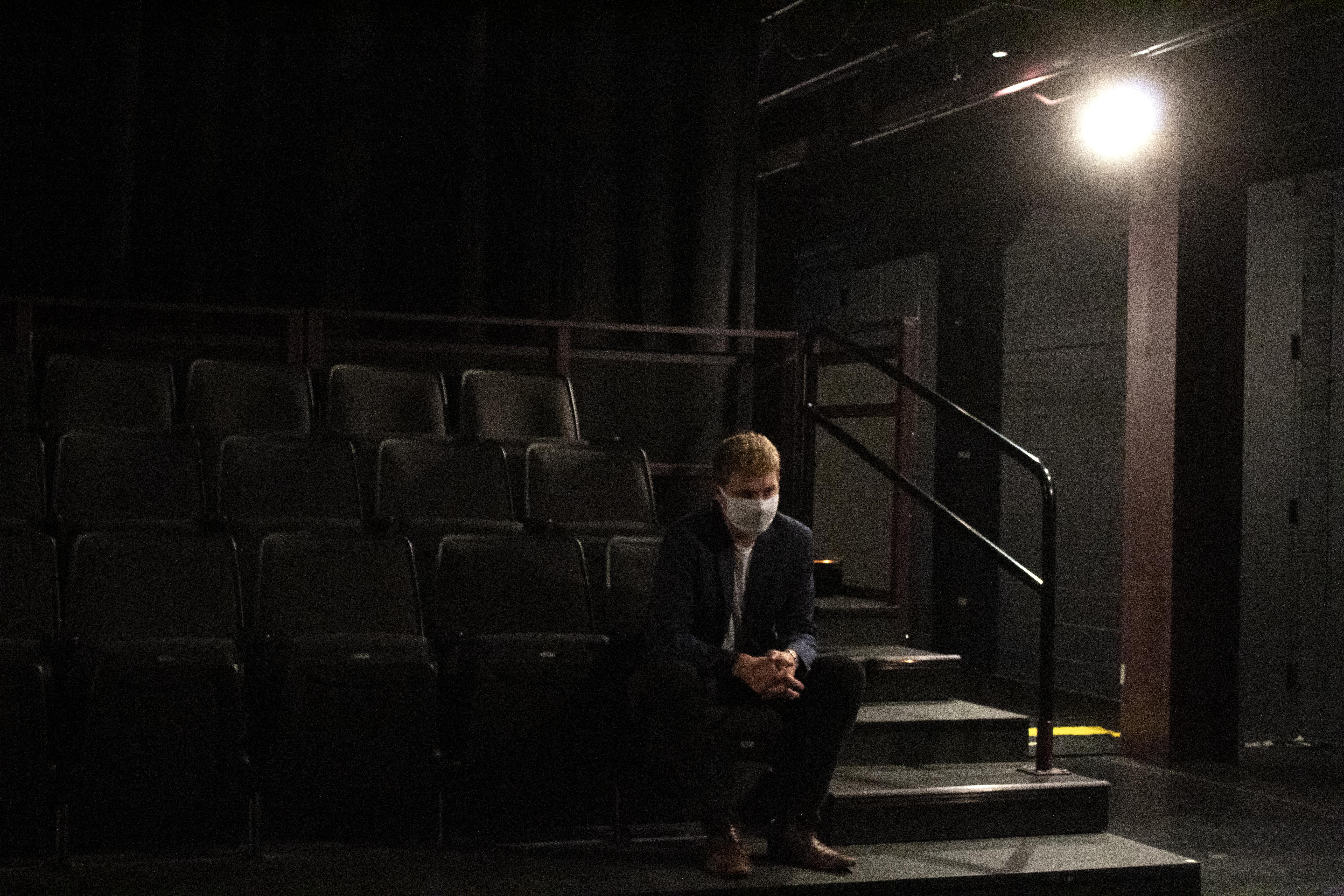 IU Junior Josh Hogan sits in the Wells-Metz Theatre. IU Title IX investigators determined associate professor Murray McGibbon sexually harassed Hogan in 2018.