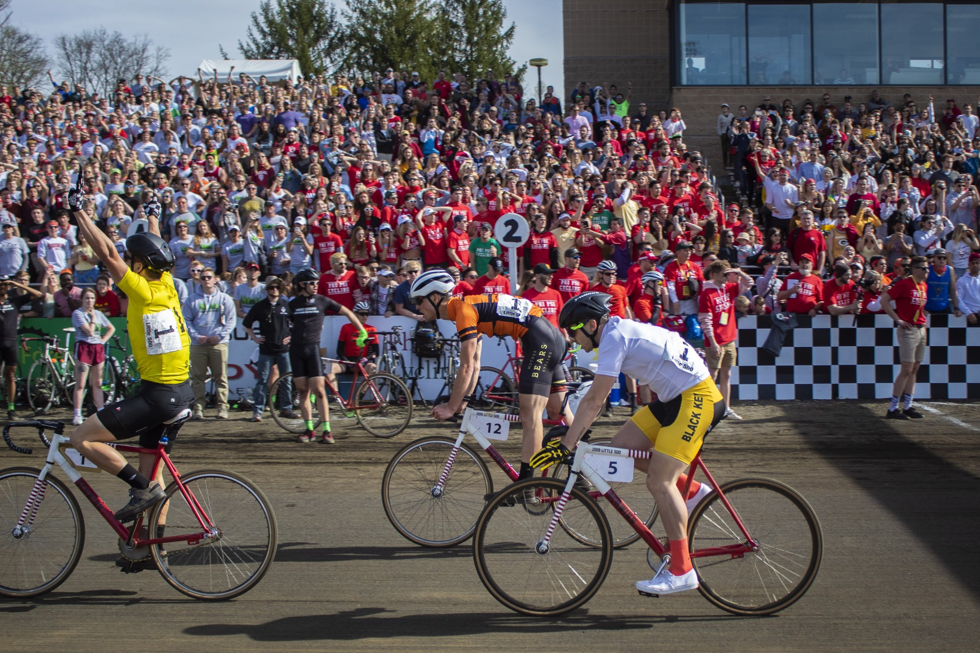 The final rider for Cutters throws his arms up in celebration after crossing the finish line April 13, 2019, at Bill Armstrong Stadium. Little 500 is typically in April, but has been rescheduled to May 26 this year.