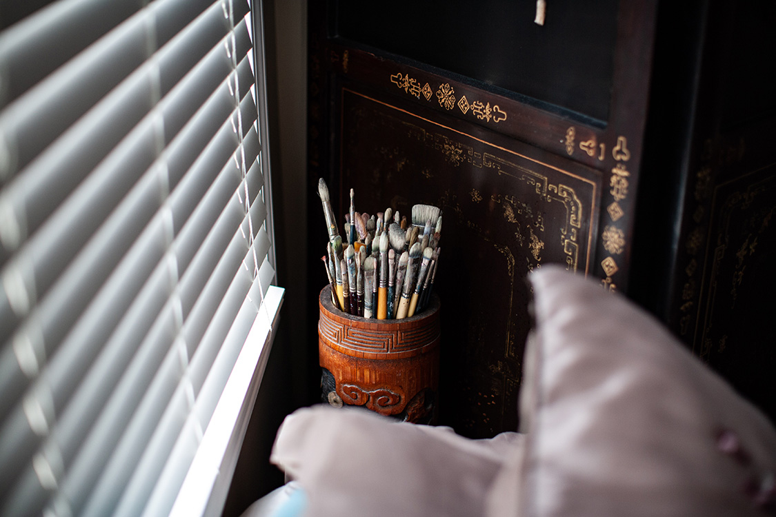 Jim's paintbrushes next to Fran's bed