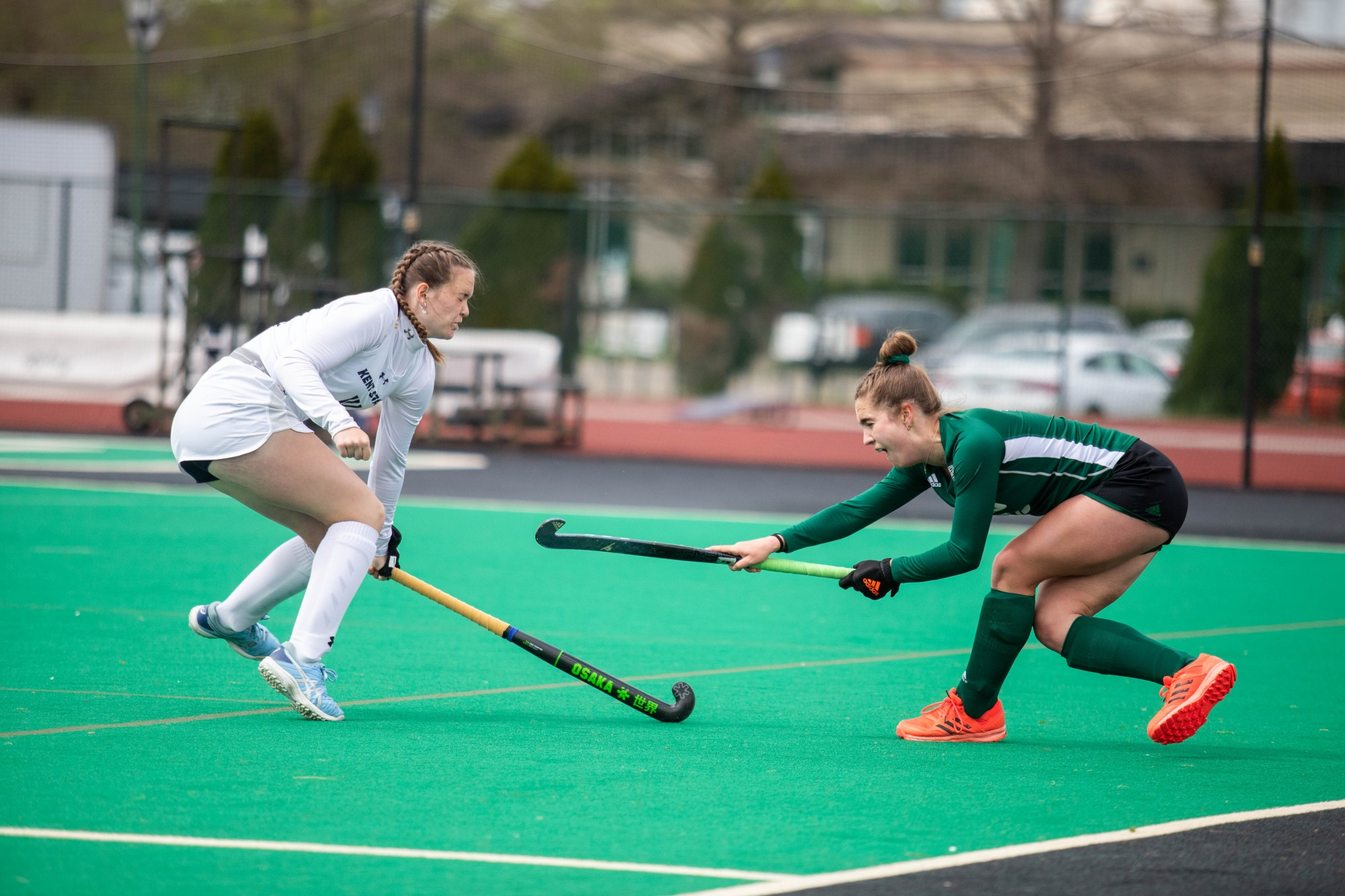 Ohio junior Courtney Klein (#15), right, hits the ball past Kent freshman Jenna McCrudden (#14), left, during the game at Pruitt Field on Friday, April 16, 2021.