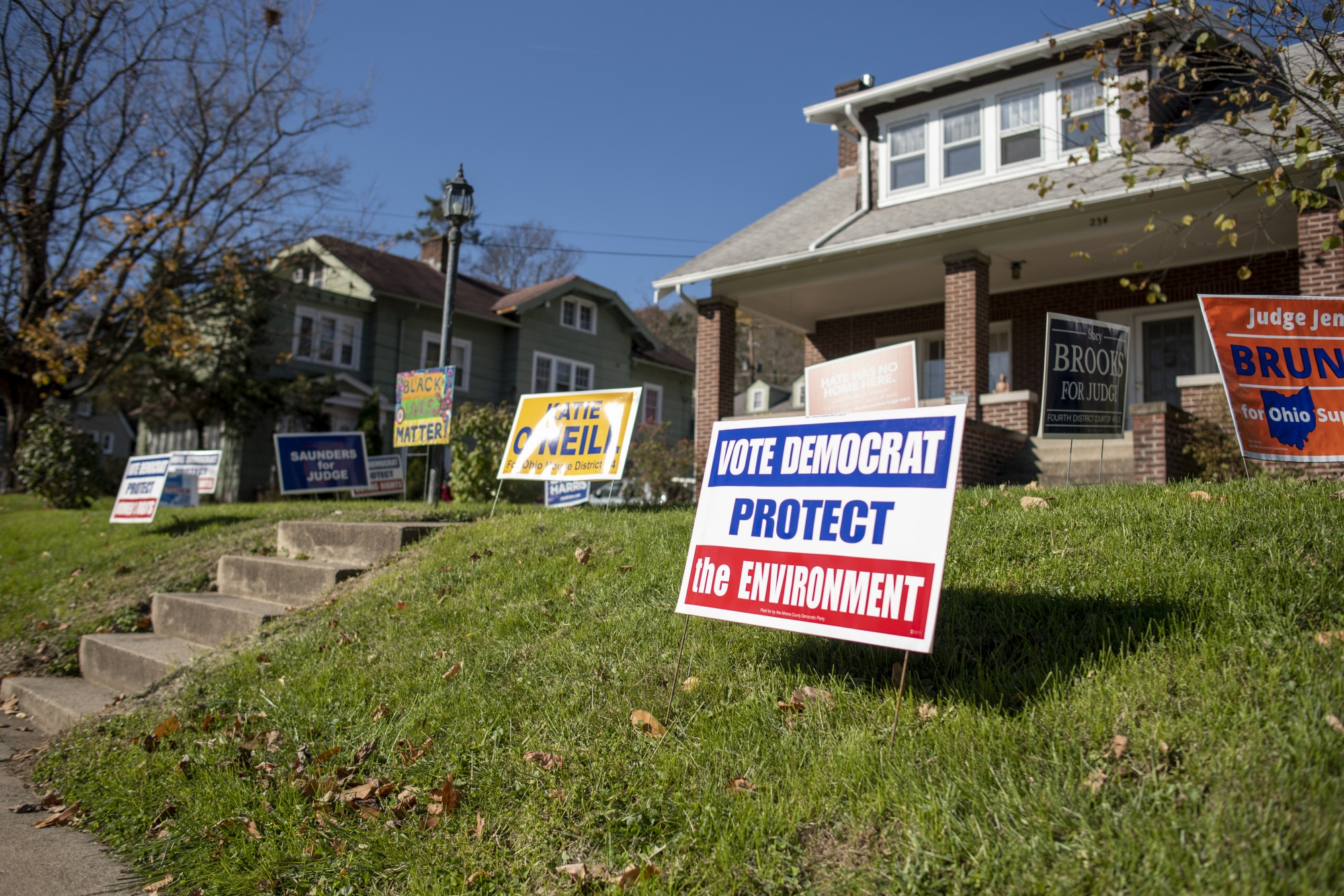 Signs supporting democratic candidates along East State Street in Athens, Ohio.