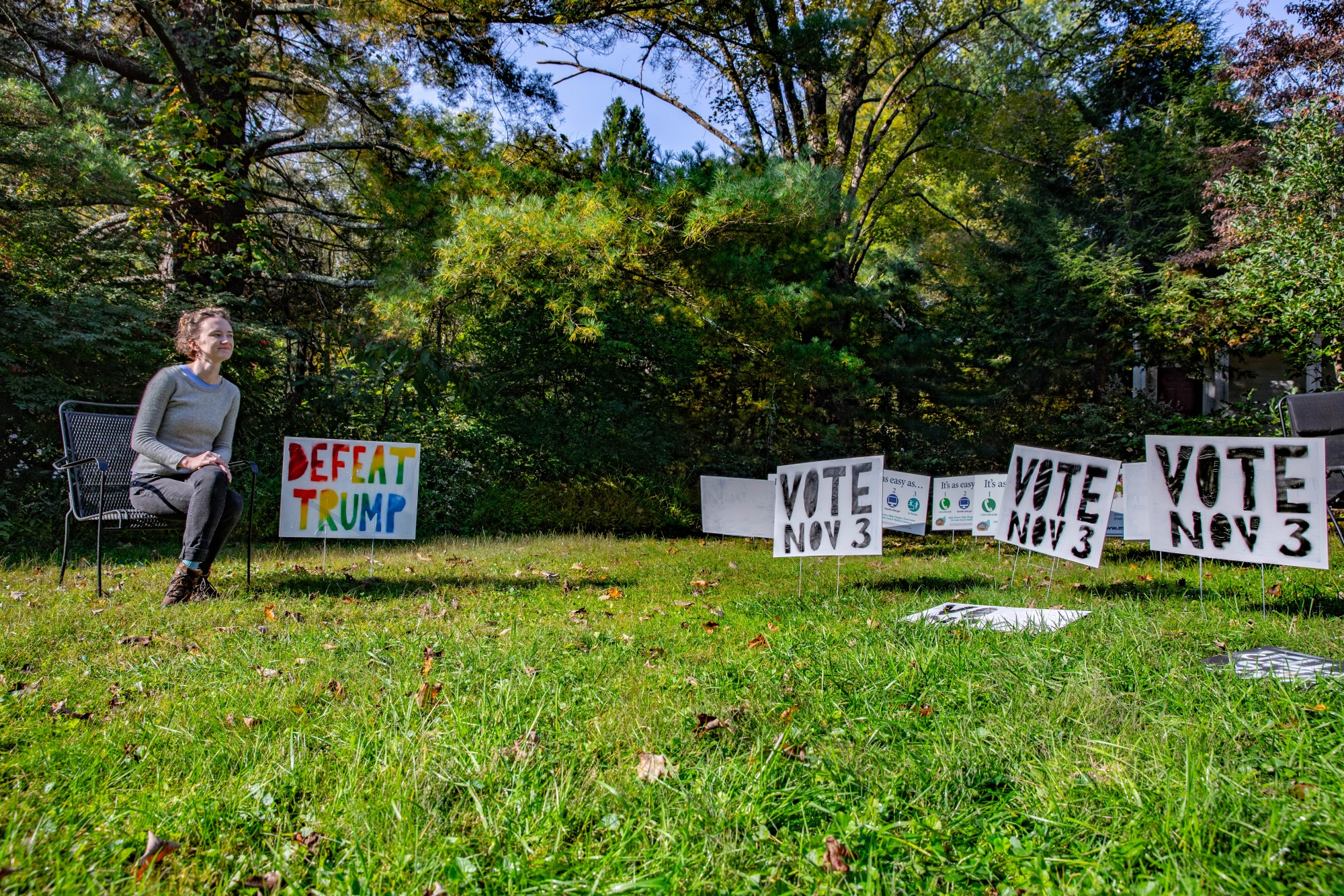 Activist Andrea Reany admires her sign-filled front yard at her home in Millfield, Ohio, on the morning of Wednesday, Oct. 7, 2020. Reany intends to be known as an organizer showing up for racial justice in southeastern Ohio while encouraging people to vote in the election next month.