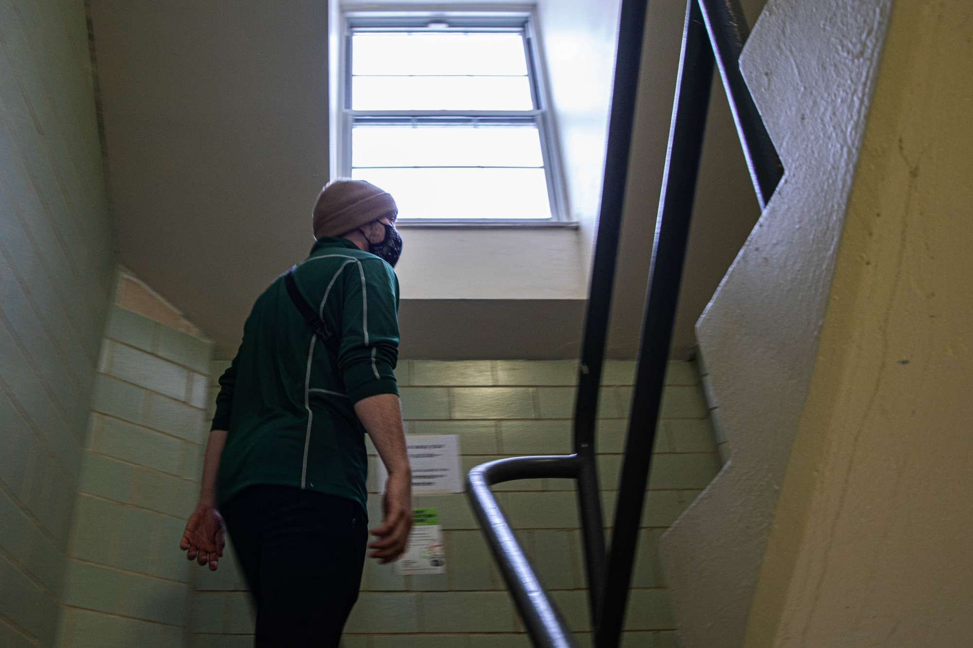 Danny Gray winds up multiple flights of stairs to reach his dorm room on the fourth floor of Tiffin Hall on Wednesday, Feb. 10, 2021. Gray is a freshman at Ohio University living on campus after students were allowed back for spring semester.