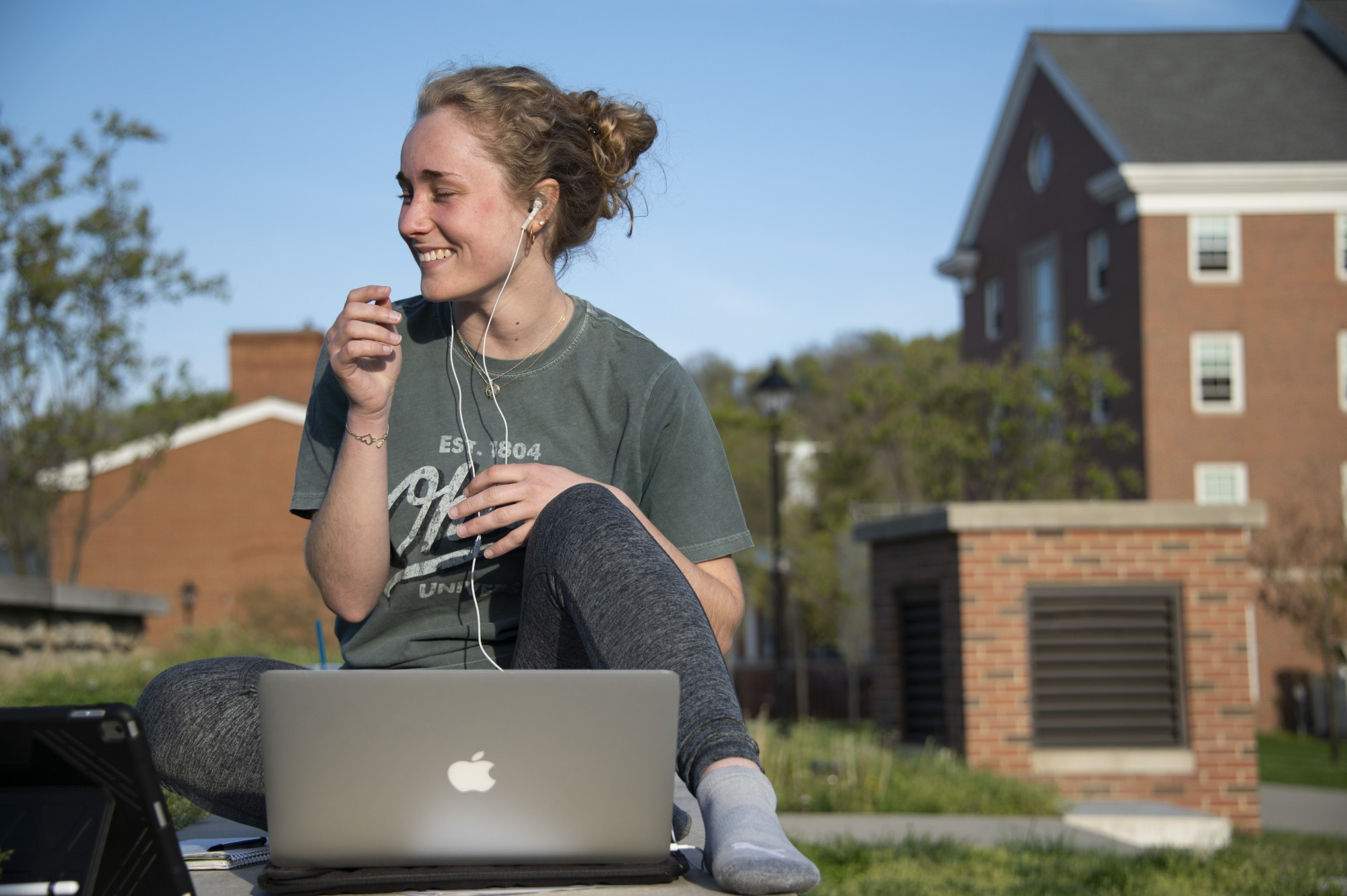 Anna Zeitzheim, a sophomore at Ohio University, studies outside while listening to music on April 13, 2021. Anna listens to music while studying to block out distractions around her and to make herself feel more at ease when working on assignments for a stressful class.