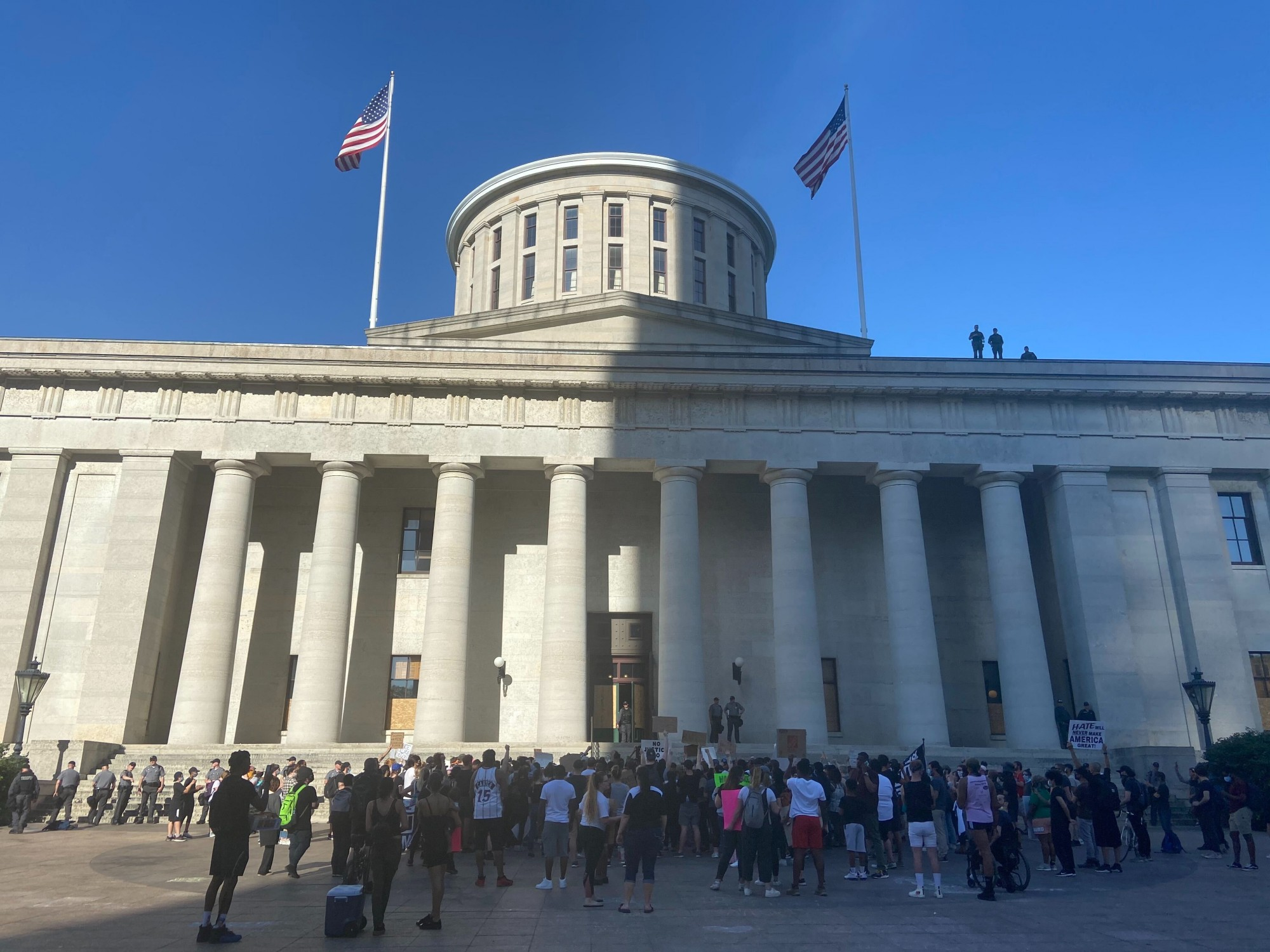 Protestors gather outside of the Ohio Statehouse.
