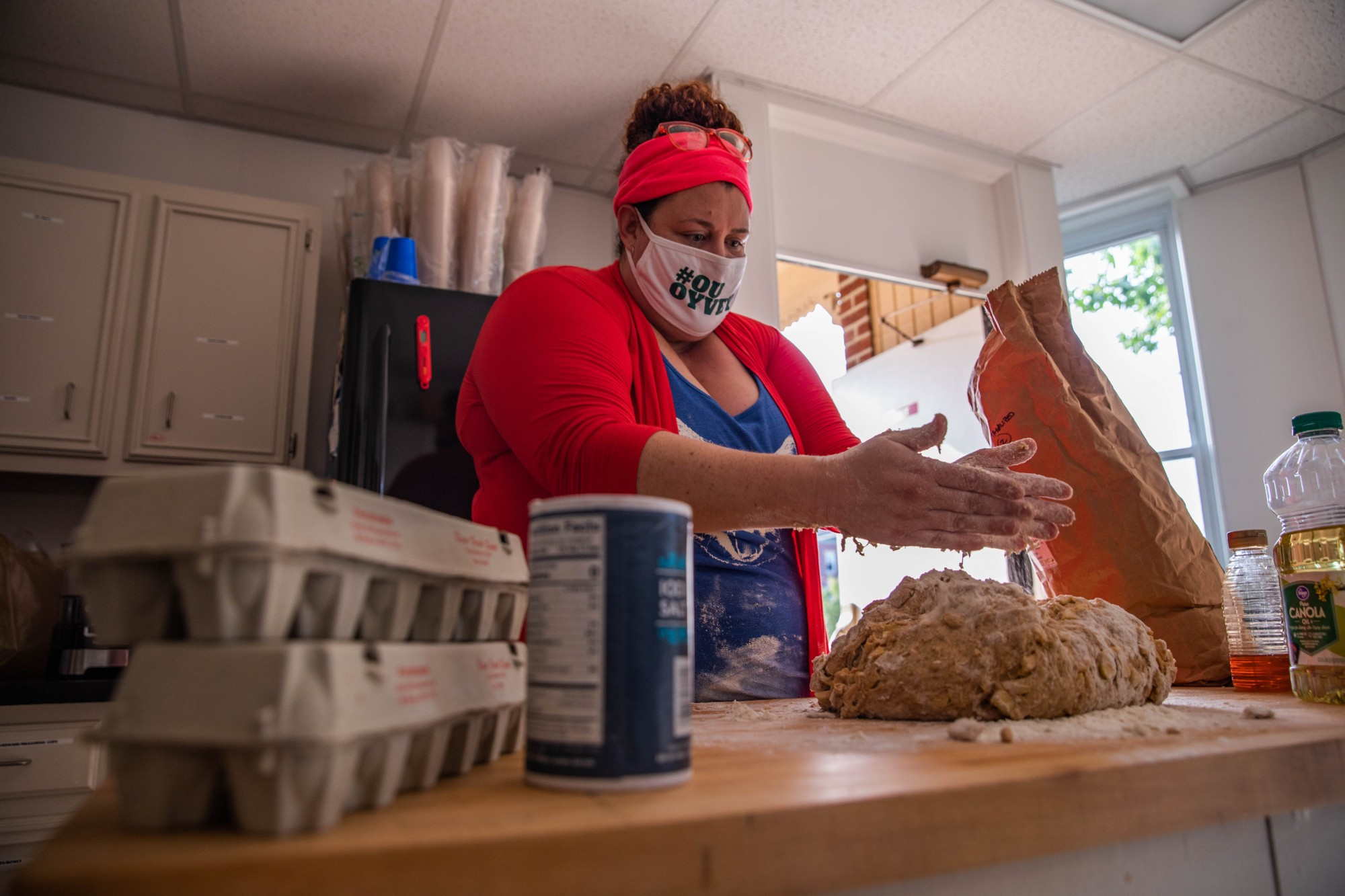 Executive Director of Hillel at Ohio University Sarah Livingston kneads challah, a bread made with apples, cinnamon and honey that is usually served for celebrating Shabbat and other major Jewish holidays.