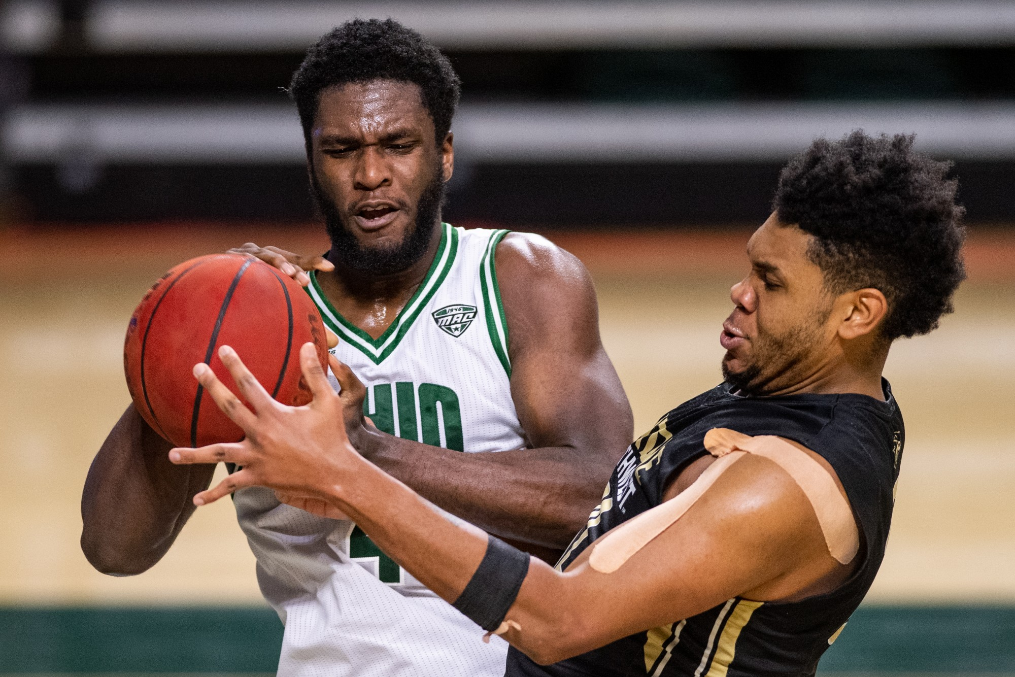 Dwight Wilson III (#4), of Ohio, takes the ball away from Perdue Northwest's Jyrus Freels (#32) during the Bobcats' game versus Perdue Northwest in The Convo on Thursday, Dec. 10, 2020. Ohio won 92-72.