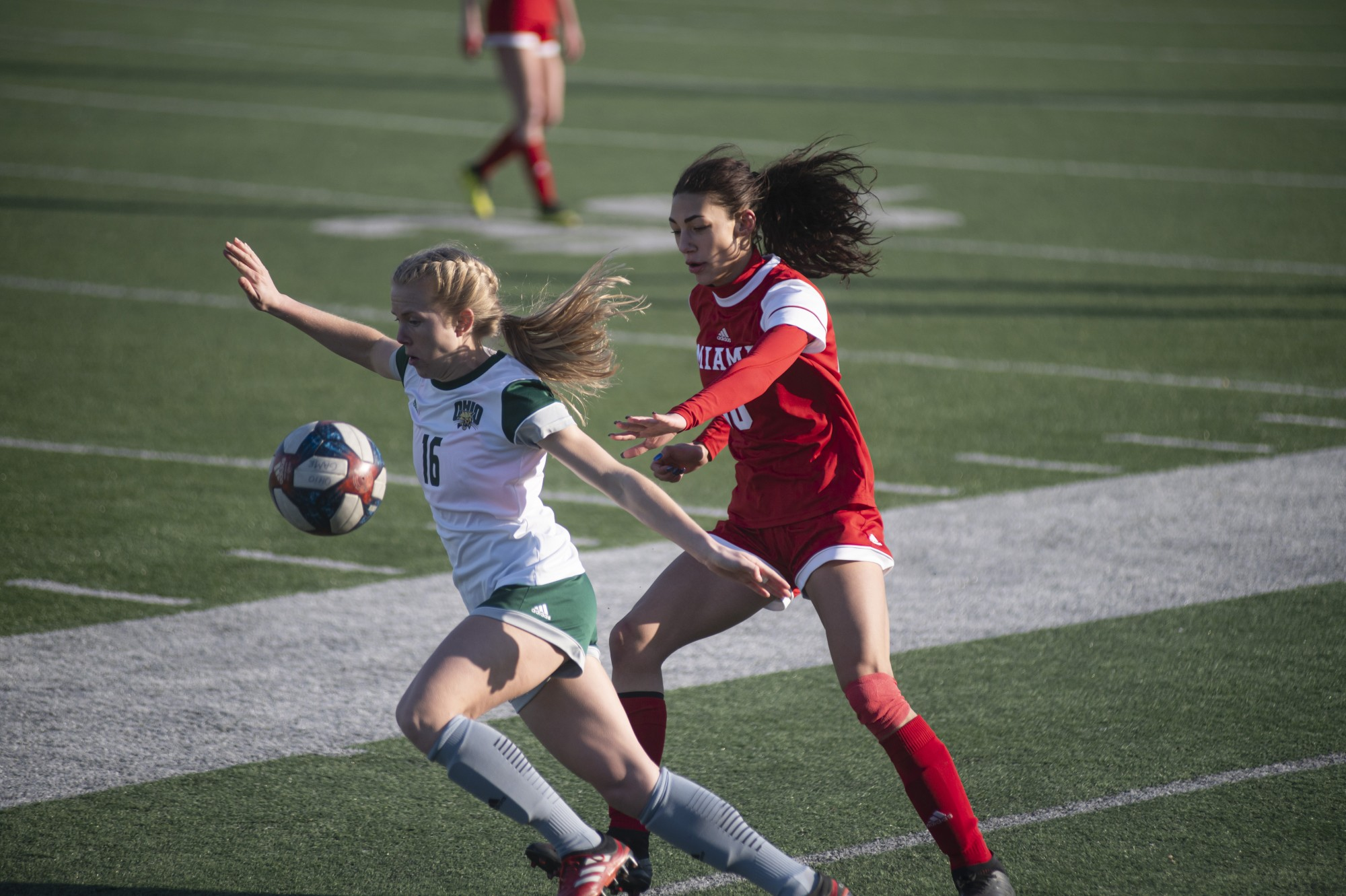 Abby Townsend (#16) guards the ball from a rival Miami player during the home game held at Peden Stadium in Athens, Ohio, on March 4, 2021. The Bobcats lost to the Redhawks 0-1.