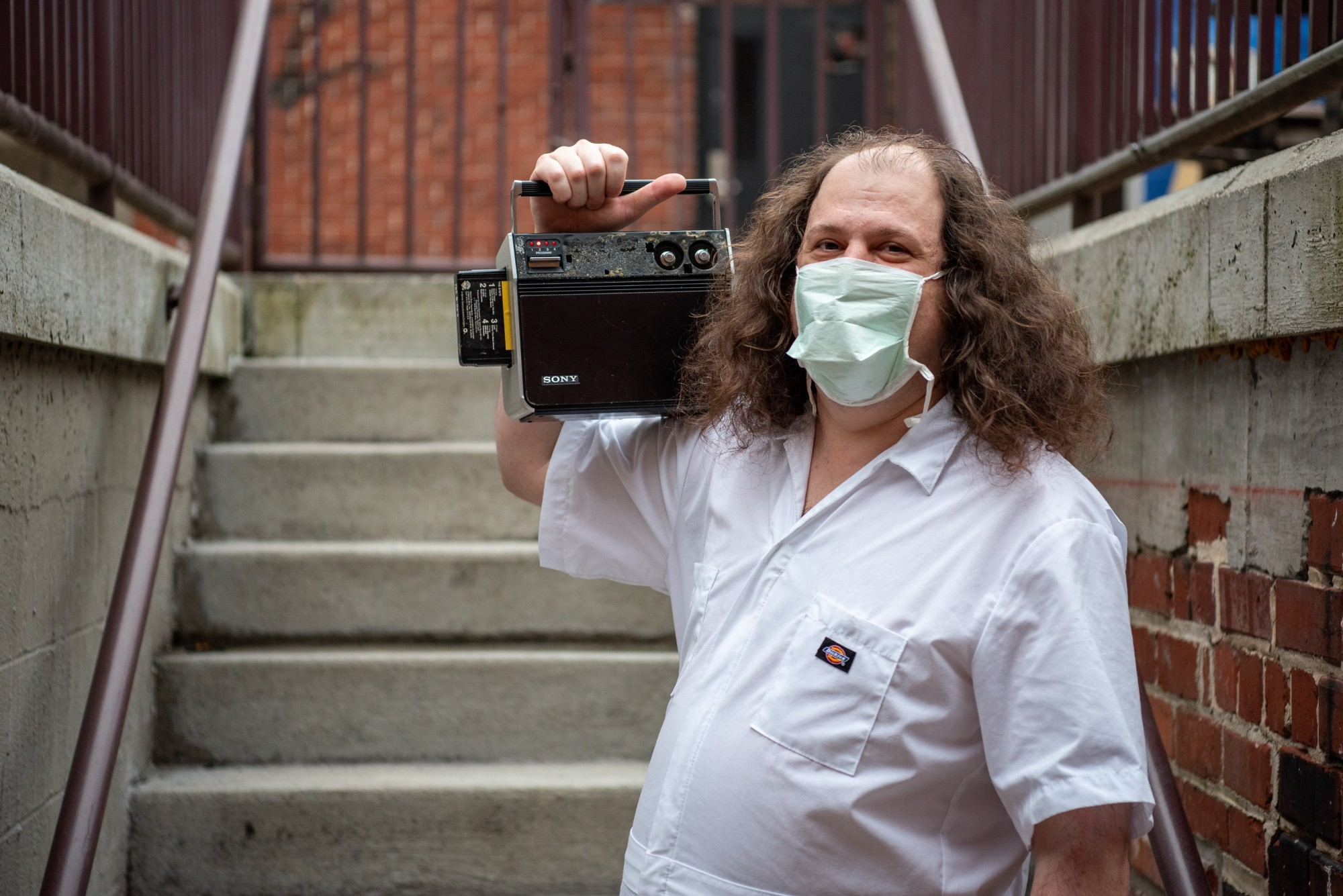 Michael Bart (or DJ Barticus) poses for a portrait on the stairs behind The Union in Athens, Ohio, on Monday, Aug. 31, 2020.